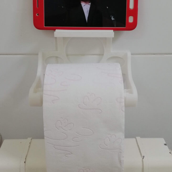 Toilet paper with a phone holder
